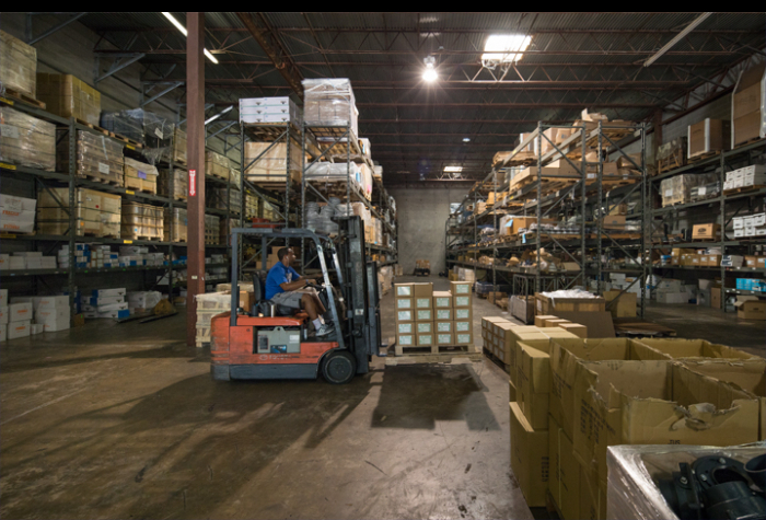 Man operating a forklift in a warehouse